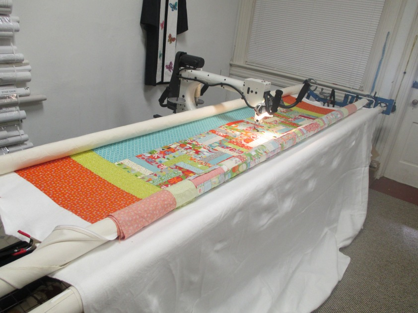 Long Arm quilting done by Sandy Merrit, using an Open Heart pantograph design.