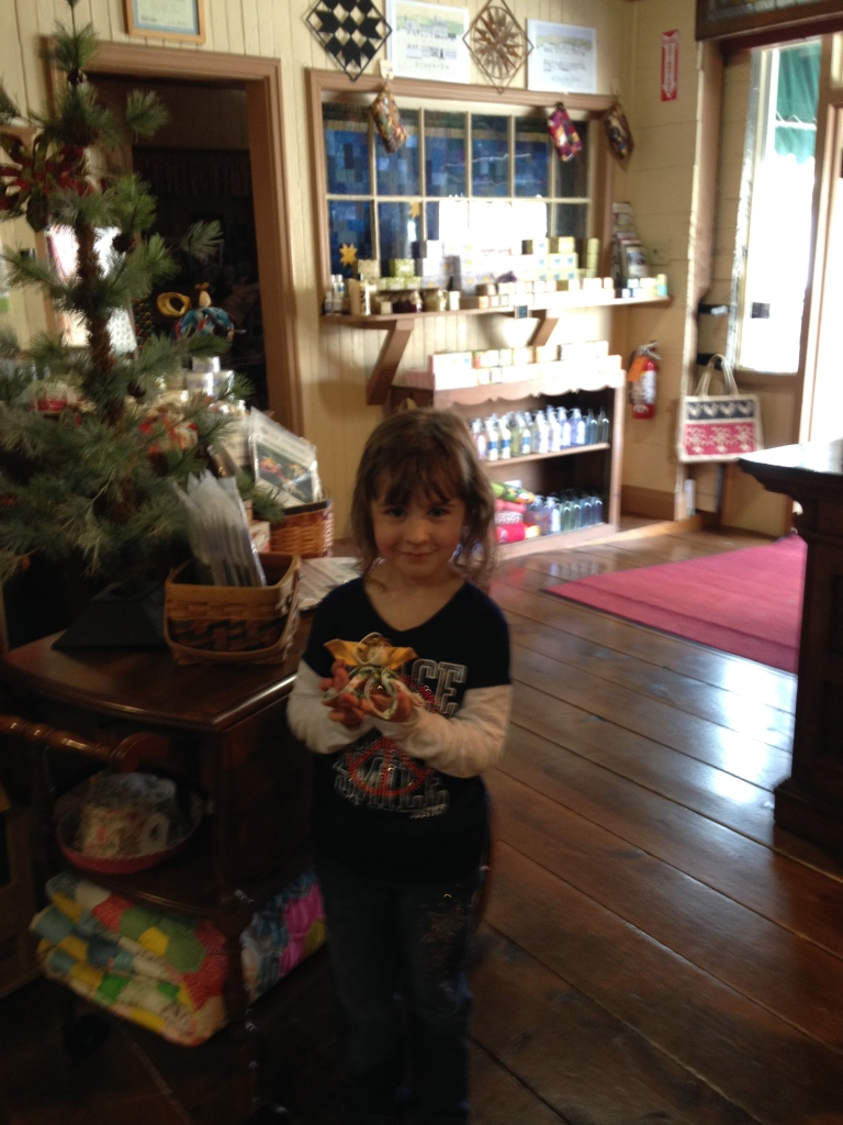 Mini-manager, Emma, 5 years old with her newly minted Holiday ornament!
